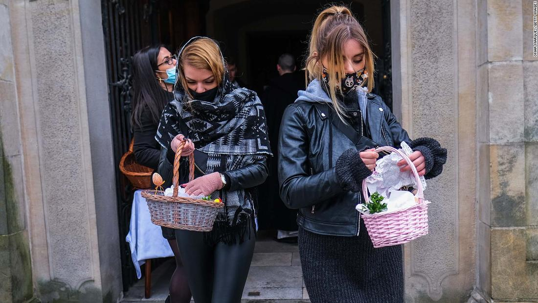 Women in Krakow, Poland, carry Easter baskets after a food-blessing ceremony at the Basilica of St. Michael the Archangel on April 3.