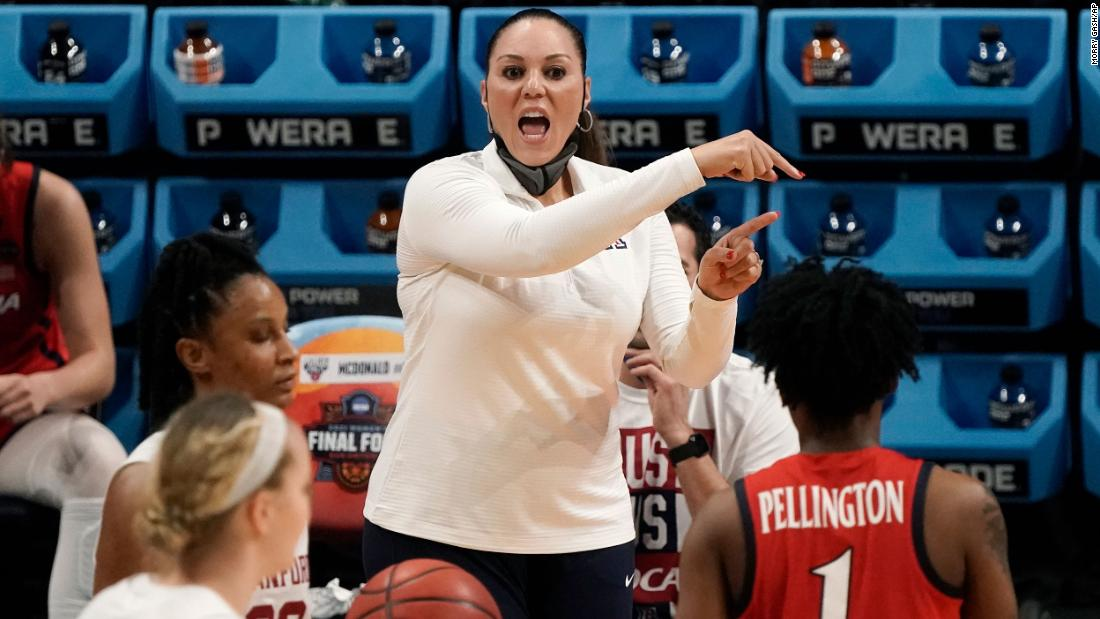 Arizona head coach Adia Barnes directs her team during the first half of Sunday's game.