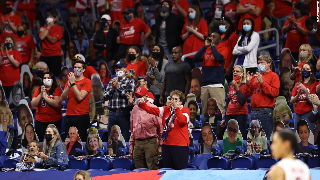 Arizona fans cheer on their team Sunday.