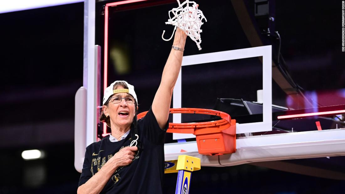 Stanford head coach Tara VanDerveer -- the winningest coach in the history of women's college basketball -- cuts down the net after Sunday's win.