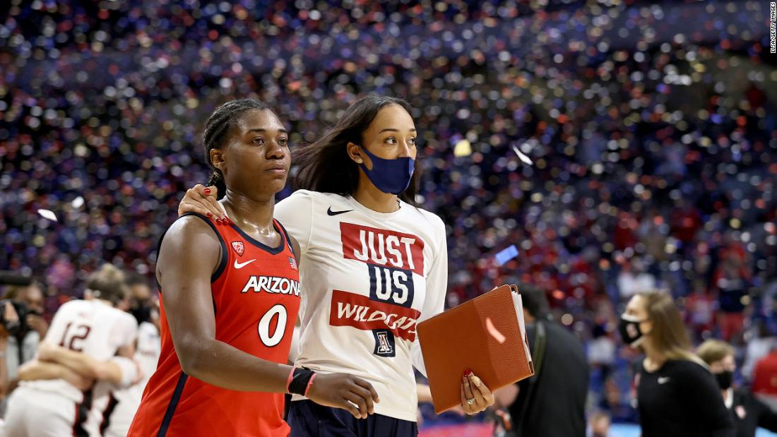 Arizona assistant coach Jackie Nared Hairston puts her arm around Trinity Baptiste after the game.