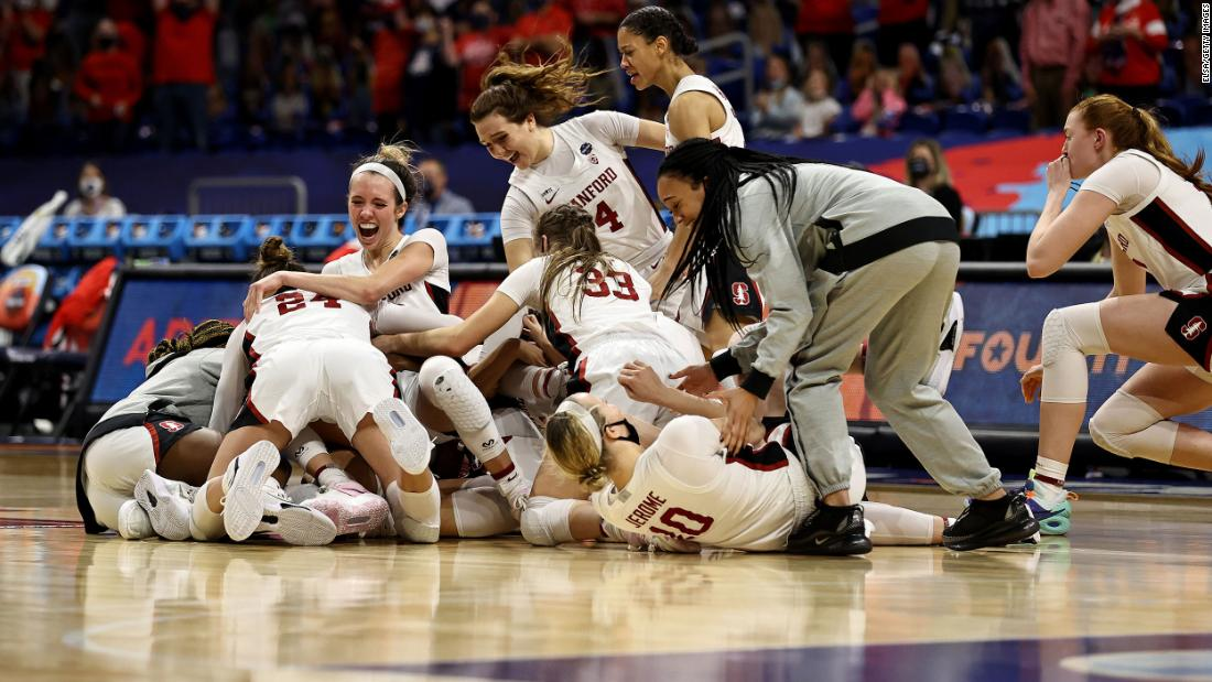 Stanford players celebrate after the final buzzer sounded in Sunday's championship game with Arizona. The Cardinal won 54-53 for the third title in school history.