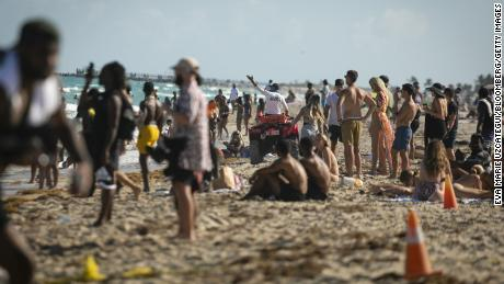 Lifeguard calls swimmers on a beach in the South Beach neighborhood in Florida on March 27.