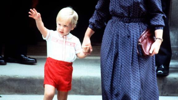 Accompanied by his nanny Barbara Barnes, Price William waves as he leaves St. Mary's Hospital after visiting his mother and his newborn brother, Prince Harry, on September 16, 1984.