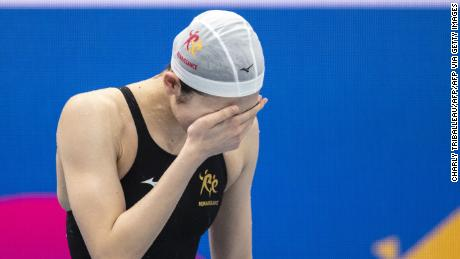 Rikako Ikee reacts to winning the 100m butterfly final at the Japan national swimming championships.