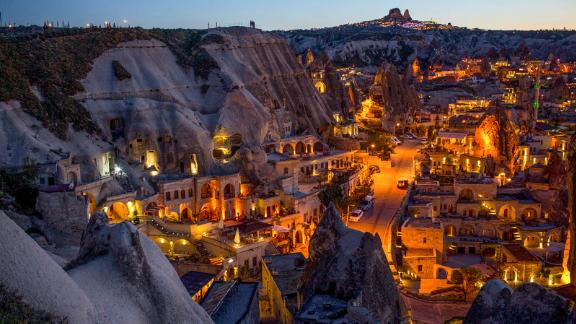 NEVSEHIR, TURKEY - APRIL 17: Light illuminates cave hotels at sunset in the town of Goreme on April 17, 2016 in Nevsehir, Turkey. Cappadocia, a historical region in Central Anatolia dating back to 3000 B.C is one of the most famous tourist sites in Turkey. Listed as a World Heritage Site in 1985, and known for its unique volcanic landscape, fairy chimneys, large network of underground dwellings and some of the best hot air ballooning in the world, Cappadocia is preparing for peak tourist season to begin in the first week of May. Despite Turkey's tourism downturn, due to the recent terrorist attacks, internal instability and tension with Russia, local vendors expect tourist numbers to be stable mainly due to the unique activities on offer and unlike other tourist areas in Turkey such as Antalya, which is popular with Russian tourists, Cappadocia caters to the huge Asian tourist market. (Photo by Chris McGrath/Getty Images)