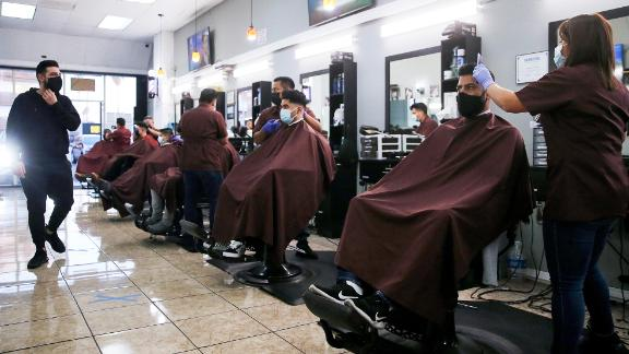 Barbers from King's Cutz give haircuts indoors while observing COVID-19 safety restrictions on March 13, 2021 in Los Angeles, California.
