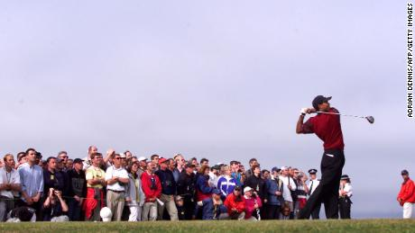 Woods tees-off on the 13th hole on the Old Course at St. Andrews at the Open Championship.
