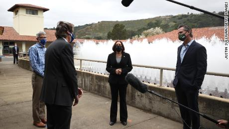 U.S. Vice President Kamala Harris (C) and California Gov. Gavin Newsom (R) tour the Upper San Leandro Water Treatment Plant on April 5, 2021 in Oakland, California. Vice President Harris is visiting the San Francisco Bay Area where she will focus on infrastructure and small businesses that are addressed in the president's $2.3 trillion infrastructure plan.