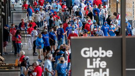 Fans walk through the main concourse of Globe Life Field before the Texas Rangers home opener baseball game against the Toronto Blue Jays on April 5, 2021.
