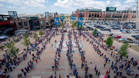 Fans line up to enter Globe Life Field before the Texas Rangers home opener baseball game against the Toronto Blue Jays on April 5, 2021, in Arlington, Texas.
