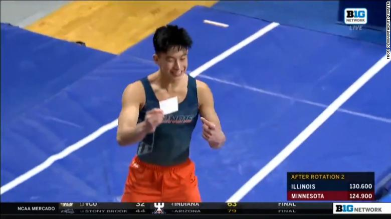 Illinois gymnast shows off Covid-19 vaccination card after sticking the landing