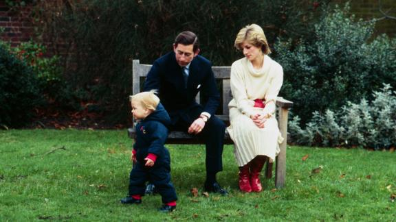 Prince William takes his first steps in public with his parents in the walled garden at Kensington Palace on December 14, 1983.