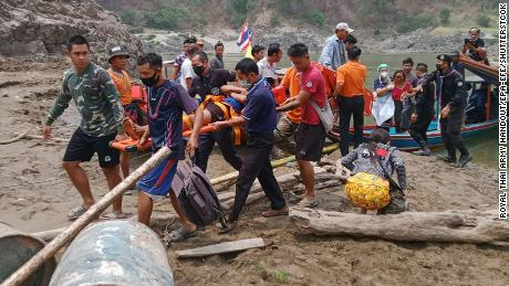 A handout photo made available by Royal Thai Army shows injured fleeing Karen villagers arriving after crossing at a Thai-Myanmar border in Mae Hong Son province, Thailand, 30 March.