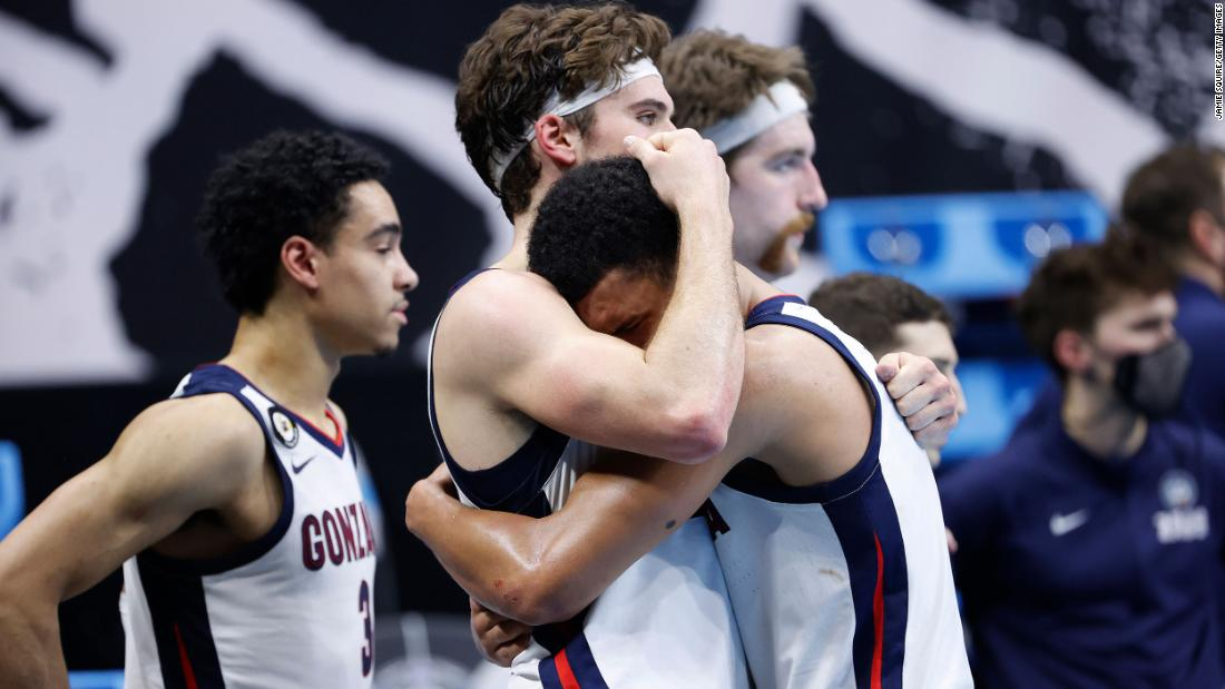 Gonzaga's Corey Kispert consoles teammate Jalen Suggs after the game.