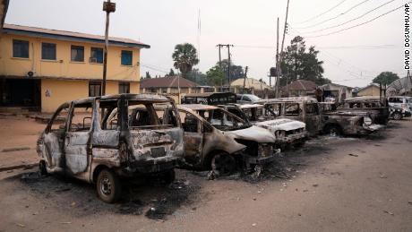 Burned vehicles are parked outside the police command headquarters in Owerri, Nigeria, on Monday, April 5, 2021.