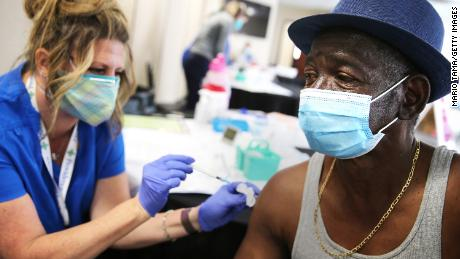 Larry Green receives a band-aid from registered nurse Teresa Frey after receiving his second dose of Moderna Covid-19 vaccine at Lincoln Memorial Congregational Church UCC last month in Los Angeles.