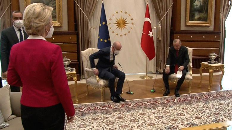 European Commission President Ursula von der Leyen (left) is seen standing as European Council President Charles Michel (center) and Turkish President Recep Tayyip Erdogan (right) take their seats.