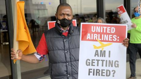 United Airlines transportation coordinator Jenkins Kolongbo protests outside the Newark Liberty International Airport in Newark, New Jersey, on April 7, 2021 after learning the company is considering layoffs.