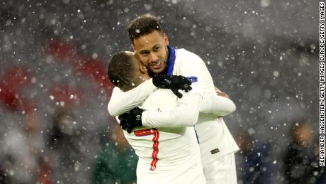 Mbappe (left) and Neymar celebrate during PSG's victory over Bayern Munich.