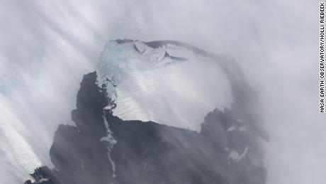 This image shows a large iceberg separated from the Pine Island Glacier.