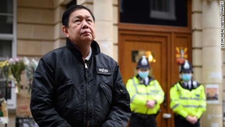Kyaw Zwar Minn listens to a statement being read on his behalf as he stands outside the Myanmar embassy in London on Thursday.