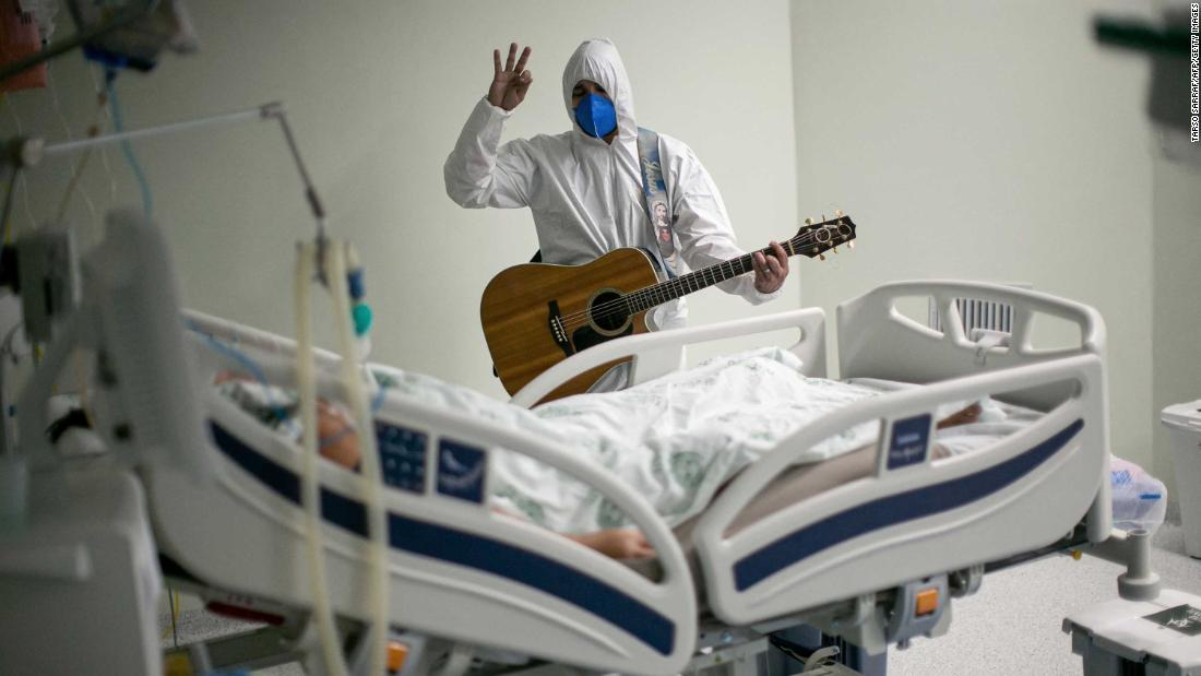 A health worker at a charity hospital in Belém, Brazil, sings and prays for a Covid-19 patient as part of Easter celebrations on April 4.