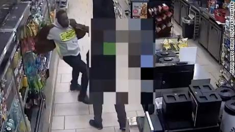 Surveillance footage appears to show a man striking an individual at a 7-Eleven in Manhattan, New York.