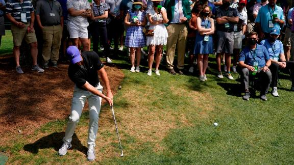 Rory McIlroy hits out of the rough on the sixth hole Thursday.