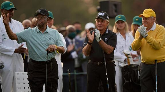 Lee Elder acknowledges applause as he joins Gary Player and Jack Nicklaus as honorary starters on Thursday. In 1975, Elder became the first African American to play in the Masters.