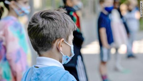 CDC's updated Covid-19 guidance for summer camps emphasizes getting vaccinated, wearing masks and staying distanced