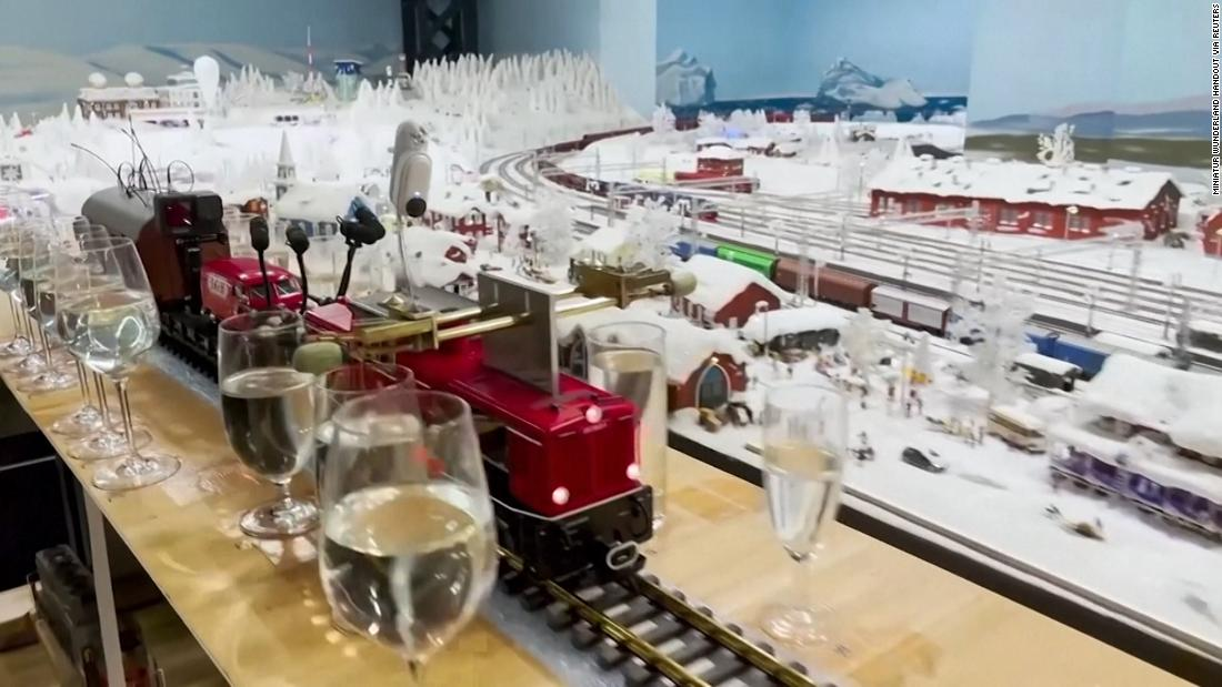 Watch model train play classical music medley with glasses