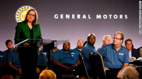 General Motors Chairman and CEO Mary Barra speaks while and United Auto Workers President Gary Jones (right) listens before they opened the 2019 GM-UAW contract talks with the traditional ceremonial handshake on July 16, 2019 in Detroit.