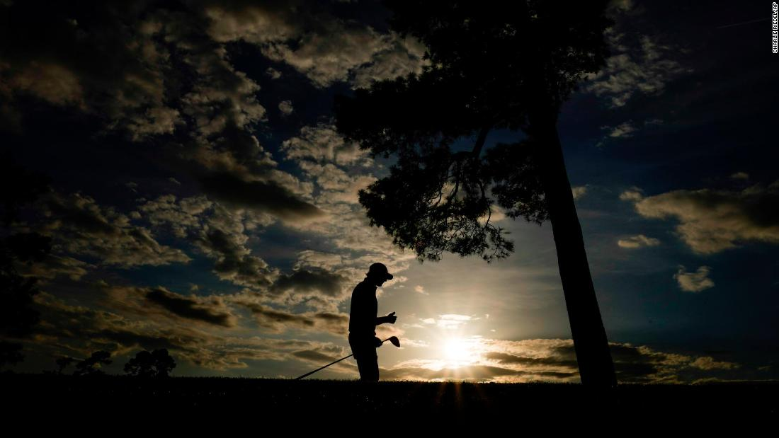Max Homa walks down the 18th fairway on Thursday.