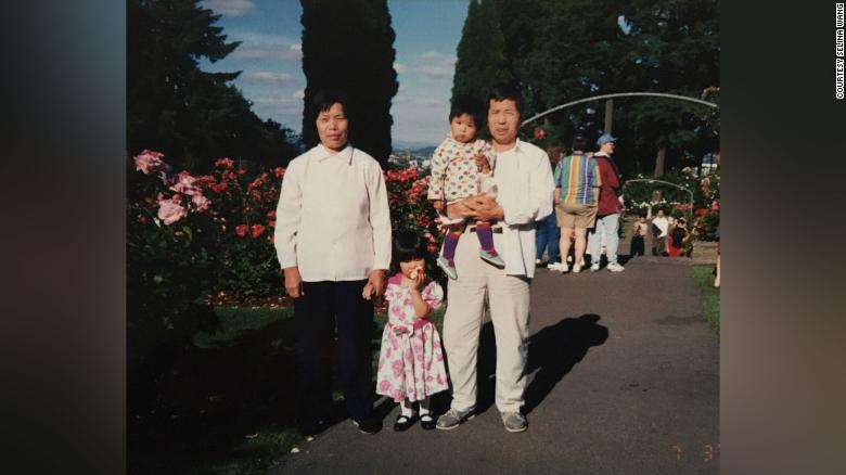 Selina and her sister with their grandparents in the US.
