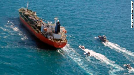 In this January 4, 2021 file photo released by Tasnim News Agency, a seized South Korean-flagged tanker is escorted by Iranian Revolutionary Guard boats on the Persian Gulf.