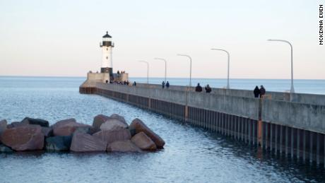 The light house along Canal Park, a popular tourist destination, guides ships into the harbor