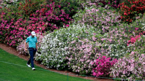 Former Masters champion Jordan Spieth walks past the azaleas on the sixth fairway Friday.