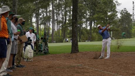 Bryson DeChambeau hits out of the pine straw on the seventh hole during the second round of the Masters.
