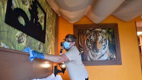A staff member cleans a room in the hotel at Chessington World of Adventures Resort in chessington, Greater London on July 4, 2020, on the first day of a major relaxation of lockdown restrictions during the novel coronavirus COVID-19 pandemic. - Fun resorts and hotels reopen as part of a wider government plan to relaunch the hospitality, tourism and culture sectors and help the UK economy recover from more than three tough months of lockdown. (Photo by Ben STANSALL / AFP) (Photo by BEN STANSALL/AFP via Getty Images)