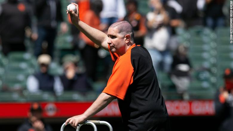 Giants fan throws ceremonial first pitch 10 years after a near-fatal attack