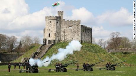 The gun salute is fired by the 104th Regiment Royal Artillery to mark the passing of Philip, the Duke of Edinburgh, at Cardiff Castle, in Wales on Saturday.