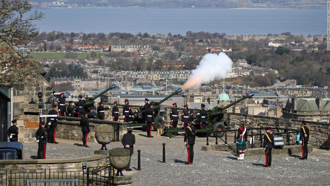 Gun salutes pay tribute to Queen Elizabeth II's husband, but UK government asks public not to gather due to strict Covid-19 restrictions