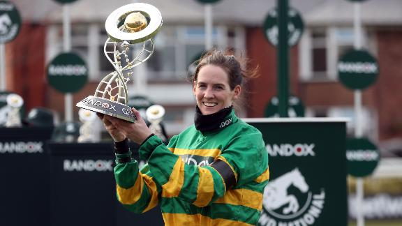 LIVERPOOL, ENGLAND - APRIL 10: Jockey Rachael Blackmore receives the Randox Grand National Handicap Chase trophy after winning on Minella Times on Grand National Day of the 2021 Randox Health Grand National Festival at Aintree Racecourse on April 10, 2021 in Liverpool, England. (Photo by David Davies - Pool/Getty Images)
