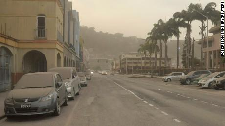 Ash covers roads a day after La Soufrière volcano erupted earlier this month in St. Vincent and the Grenadines.
