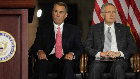 WASHINGTON, DC - SEPTEMBER 10:  U.S. Speaker of the House Rep. John Boehner (R-OH) (L) and Senate Majority Leader Sen. Harry Reid (D-NV) (R) listen to remarks during a Congressional Gold Medal presentation ceremony at the Emancipation Hall of the U.S. Capitol Visitors Center September 10, 2014 on Capitol Hill in Washington, DC. The Congressional Gold Medal was awarded in honor to the men and women who were killed during the September 11th attacks for their heroic sacrifices.  One of the three medals will be provided to the Flight 93 National Memorial in Pennsylvania, the second will go to the National September 11 Memorial and Museum in New York, and the third one will be directed to the Pentagon Memorial at the Pentagon.  (Photo by Alex Wong/Getty Images)