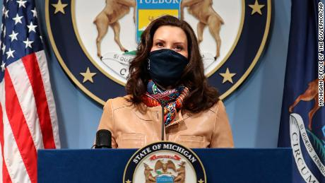 In this photo provided by the Michigan Office of the Governor, Gov. Gretchen Whitmer addresses the state during a speech in Lansing, Mich. Friday, April 9, 2021. Faced with the country's highest rate of new coronavirus infections, Whitmer on Friday urged a two-week suspension of in-person high school classes, all youth sports and indoor restaurant dining. (Michigan Office of the Governor via AP)