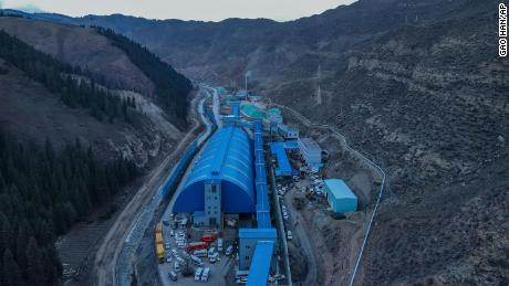 An aerial photo of the flooded coal mine in Xinjiang, China's far west, where 21 miners are trapped.