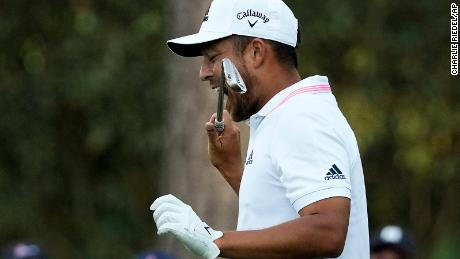 Schauffele bites his club after taking his second tee shot on the 16th hole during the final round of the Masters.