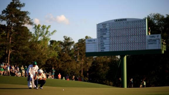 Matsuyama lines up a putt on the 18th green Sunday.